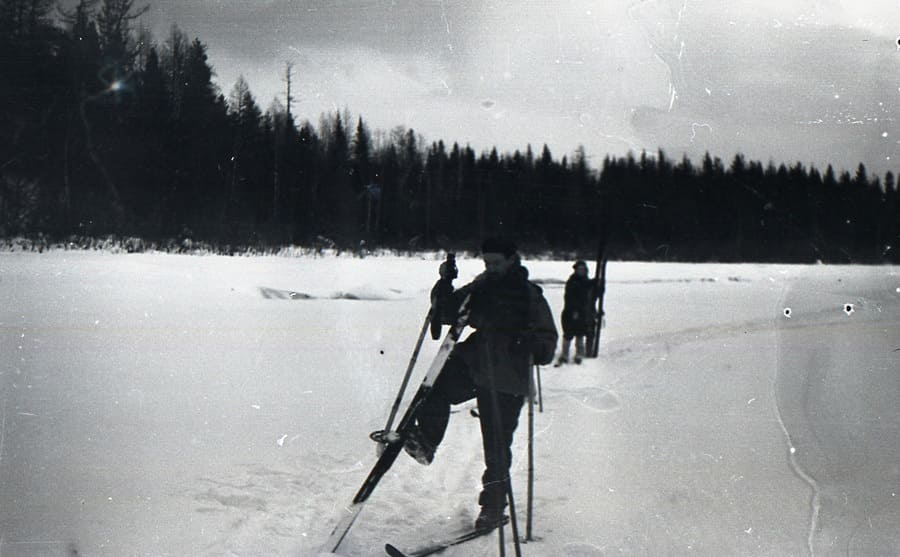 Zolotaryov and Kolmogorova, two hikers, stopping and taking their skis off