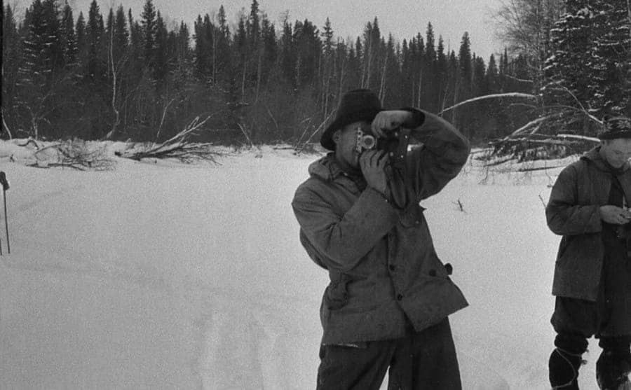 Thibeaux-Brignolle taking a photograph of Krivonishchenko who is taking a photograph