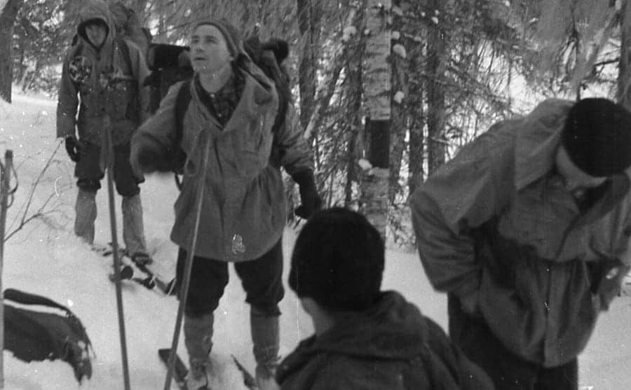 Kolevatov (in the back), Slobodin, and Zolotoryov trudging through the woods on their skiis
