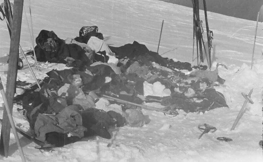 The ruins of what was left of the hikers clothing and skis scattered around the snow