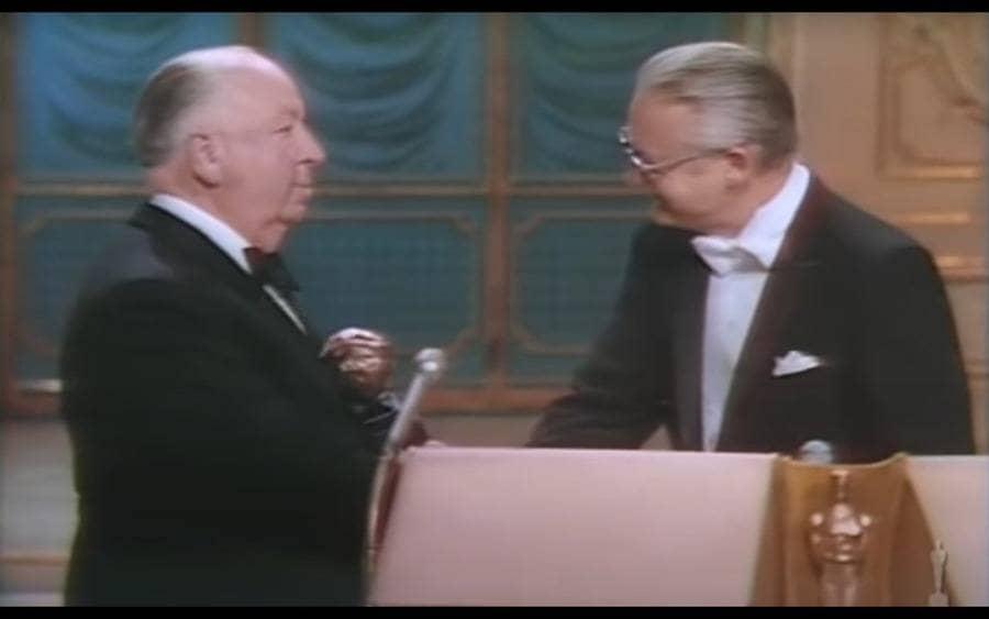 Hitchcock receiving the Irving G. Thalberg Memorial Award