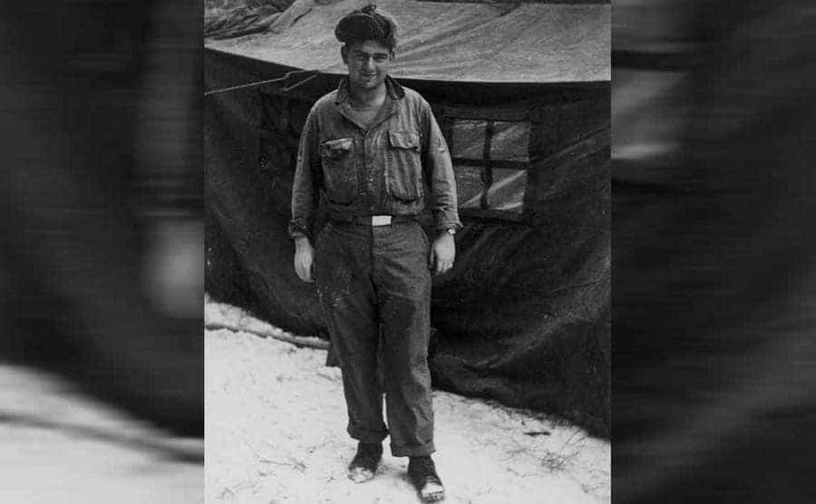 Dave Thomas in his uniform in front of a tent