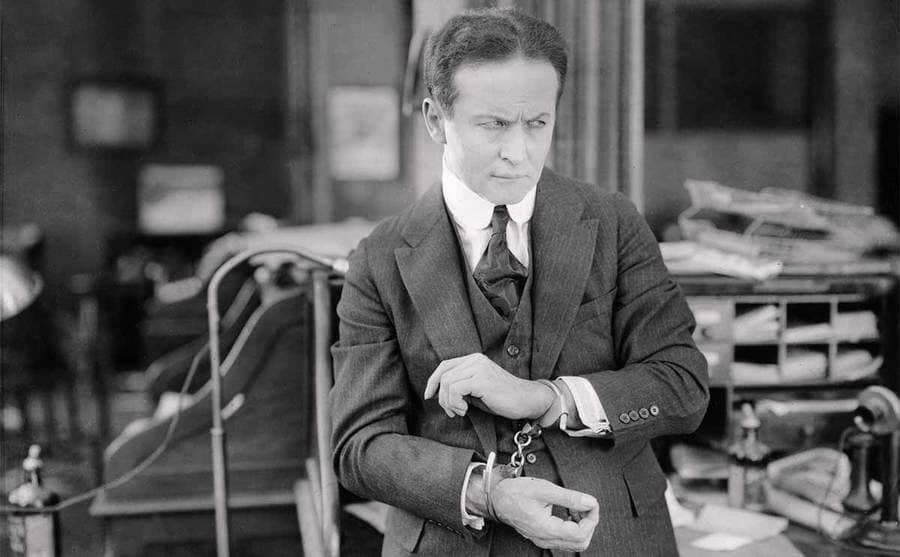 Houdini with handcuffs on