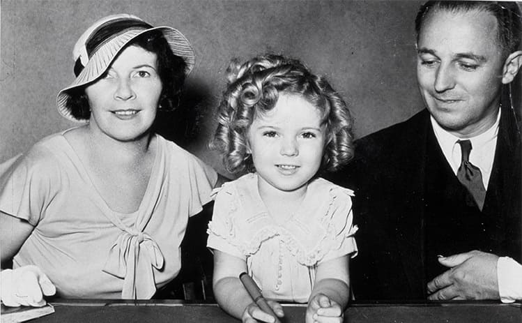 Shirley Temple with her parents Gertrude and George Temple.