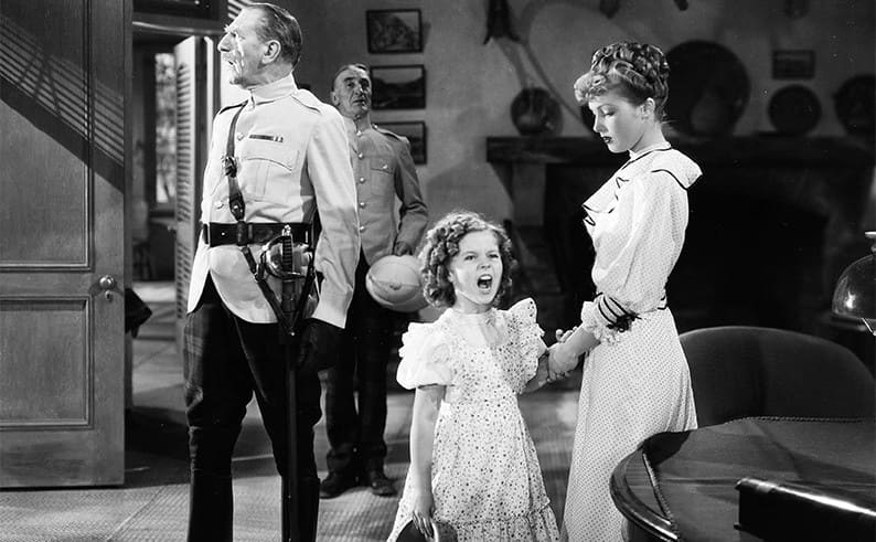 C Aubrey Smith, Shirley Temple, and June Lang in Wee Willie Winkie 1937.