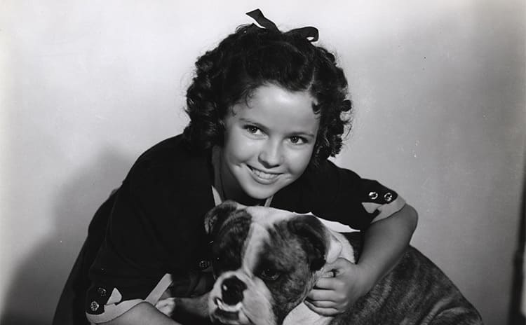 Shirley Temple with a cute dog in The Blue Bird