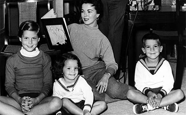 Shirley Temple reading to her children