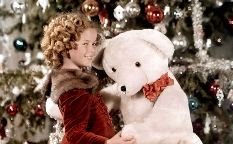 Shirley Temple as a young girl holding a large stuffed polar bear