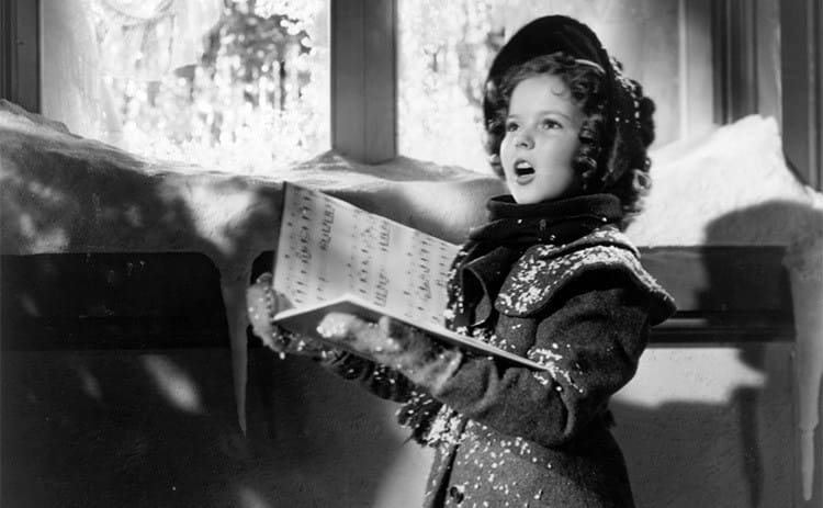 Shirley Temple singing with Christmas decorations around her