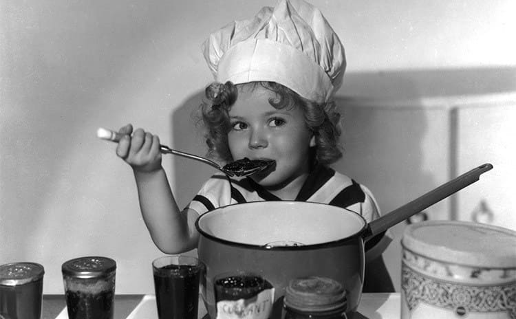 Shirley Temple as a young girl eating jelly