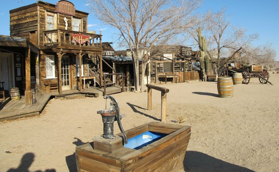 An old western town with a small drinking well