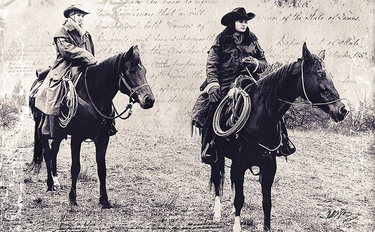 Two cowgirls on horses