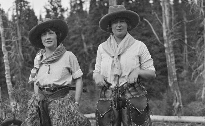 Two cowgirls with large scarves around their necks