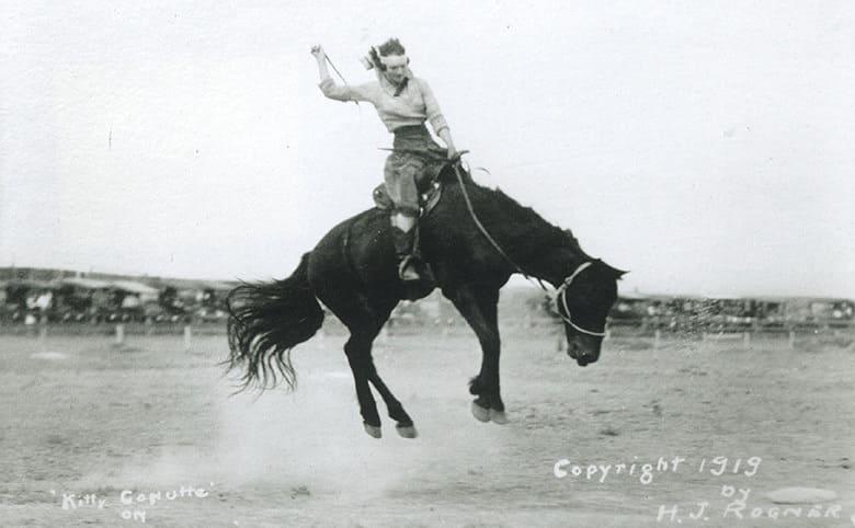 Kitty Cannut riding a horse