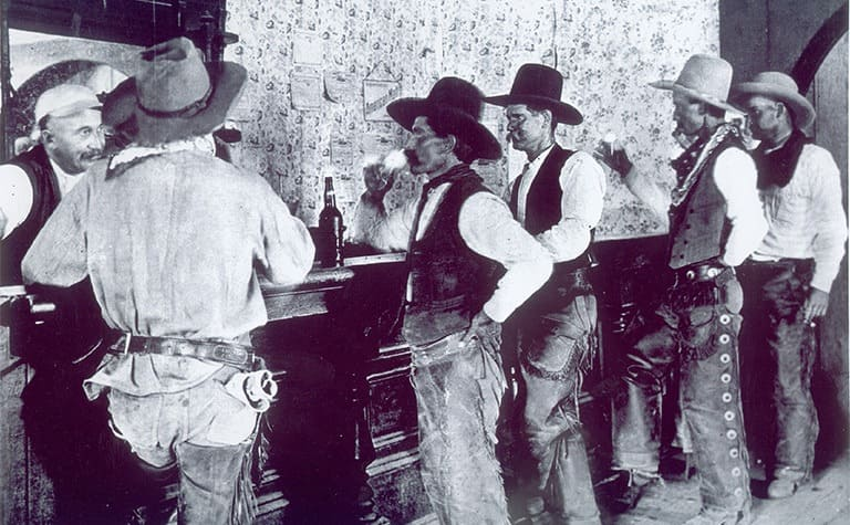 Cowboys drinking in a saloon