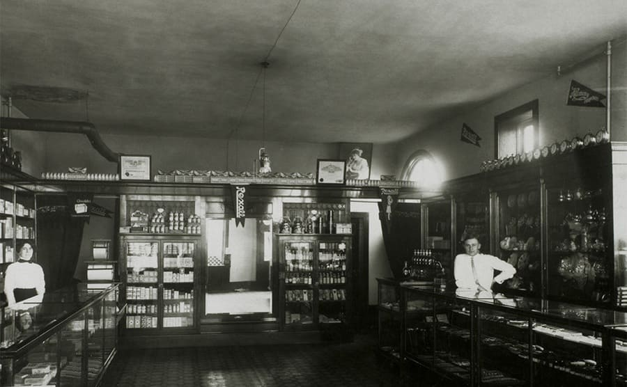 Employees in a drug store circa 1900