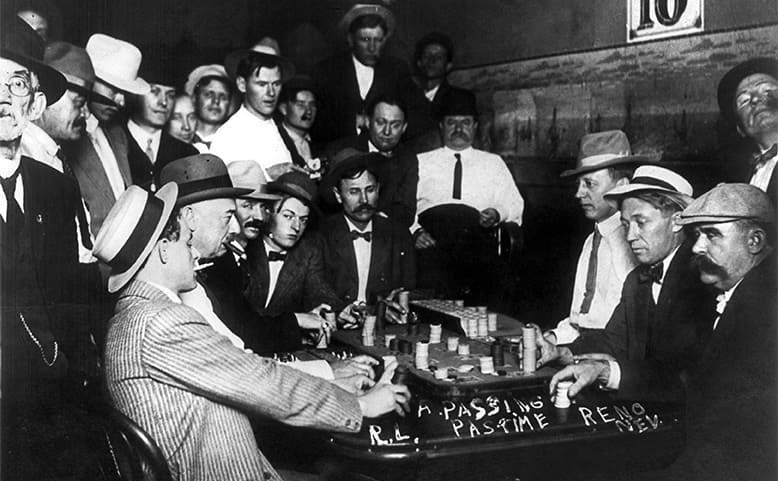 Men playing a game of Faro while other men observe