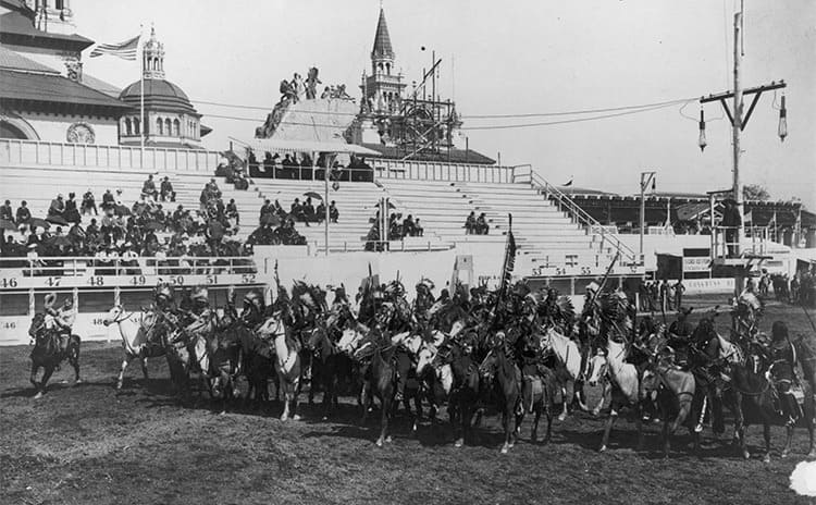 Native Americans mounted on horseback during a wild west show in 1901