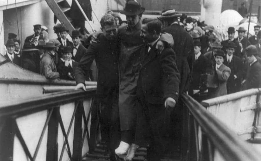 Survivors of Titanic being helped upon landing back in New York
