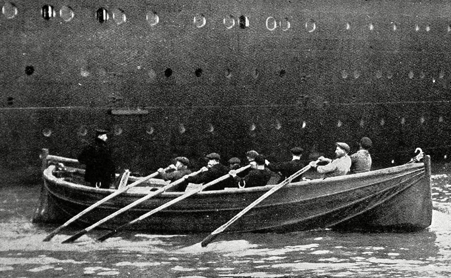 Some of the crew from the Olympic in a lifeboat after the disaster of the Titanic