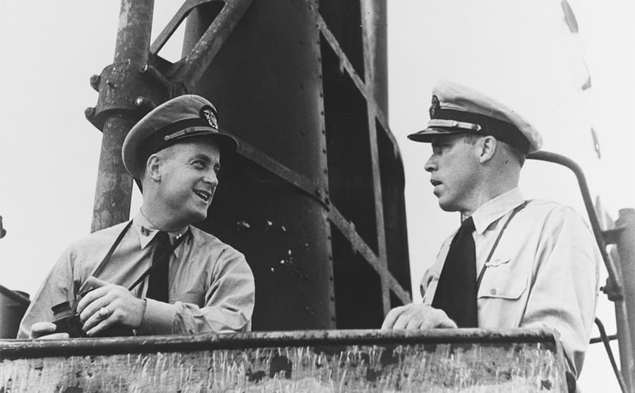 Dudley Morton and his executive officer Lieutenant Richard H O'Kane standing on the Wahoo's open bridge docked at Pearl Harbor