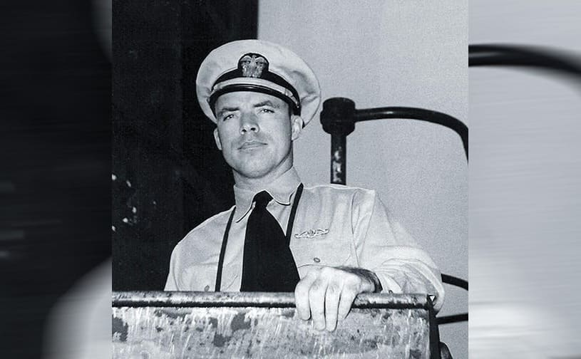 Dudley Mush Morton standing on the open deck of the USS Wahoo