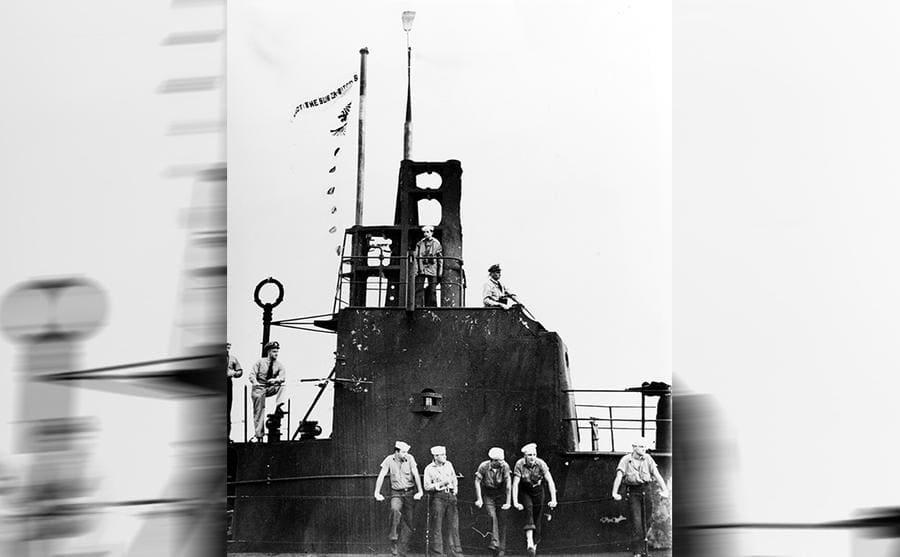 Crew members, including Dudley Morton, standing on the open bridge of the USS Wahoo circa 1943