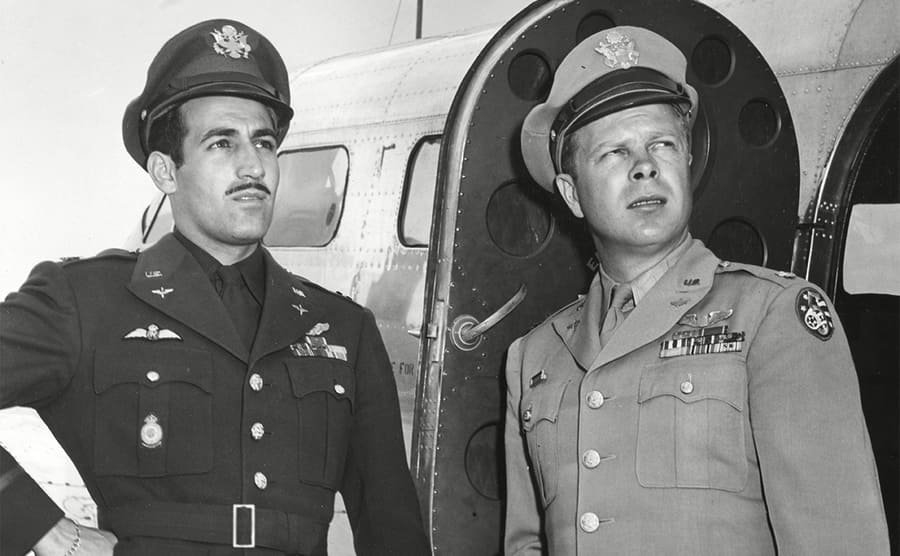 Don Gentile and Richard Bong posing next to an aircraft