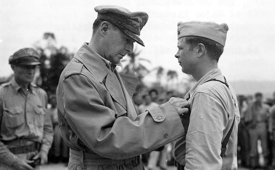 Richard Bong receiving a medal from a commanding officer