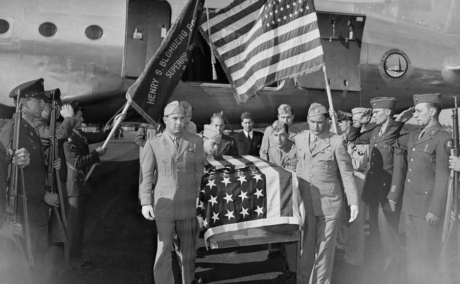 Richard Bong's funeral service with other air force members carrying his casket covered in an American flag