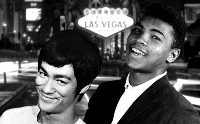 Bruce Lee and Muhammad Ali in front of a Las Vegas sign