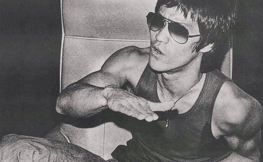 Bruce Lee wearing large sunglasses