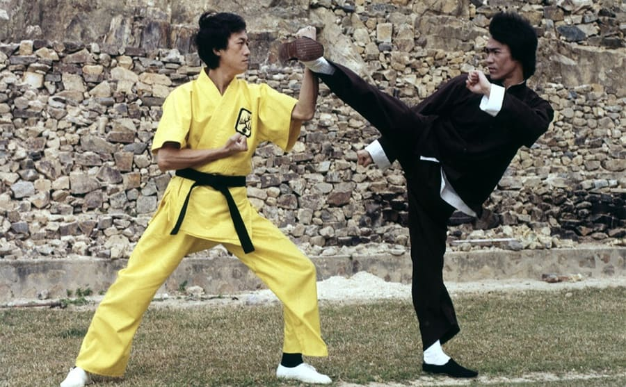 Bruce Lee doing Kung Fu with another man in the film Enter the Dragon