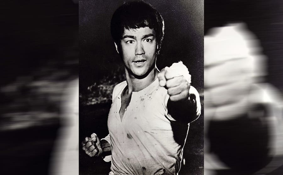 Bruce Lee with his first out in front of him