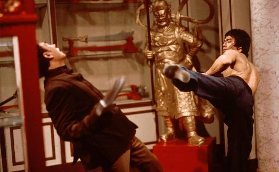 Bruce Lee in a fight scene with Kien Shih in the film Enter the Dragon