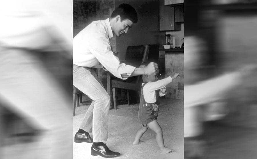 Bruce Lee showing his son Brandon Lee a kung fu move