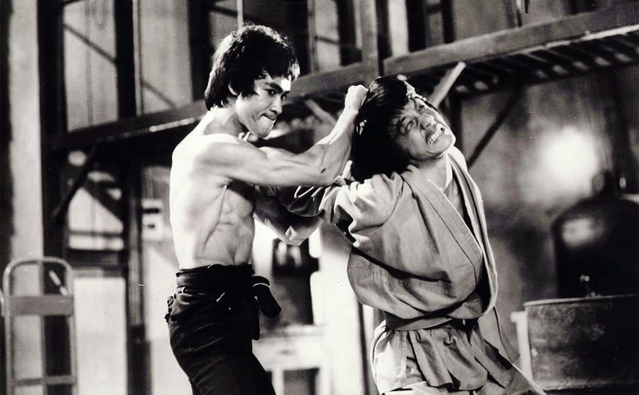 Bruce Lee and Jackie Chan fighting in a scene from the film Enter the Dragon