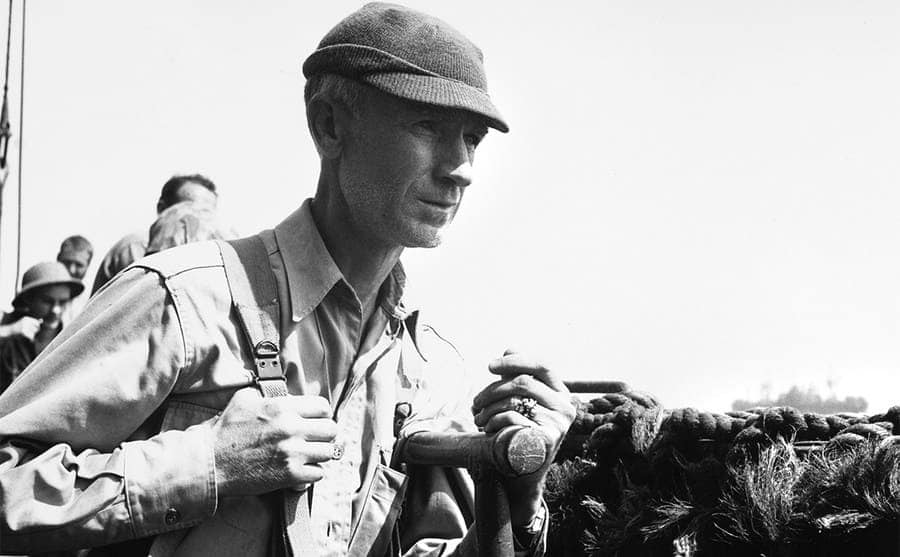 Ernie Pyle with a backpack on