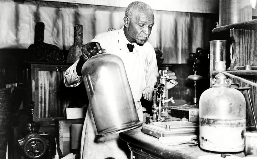 Dr George Washington Carver working in a lab