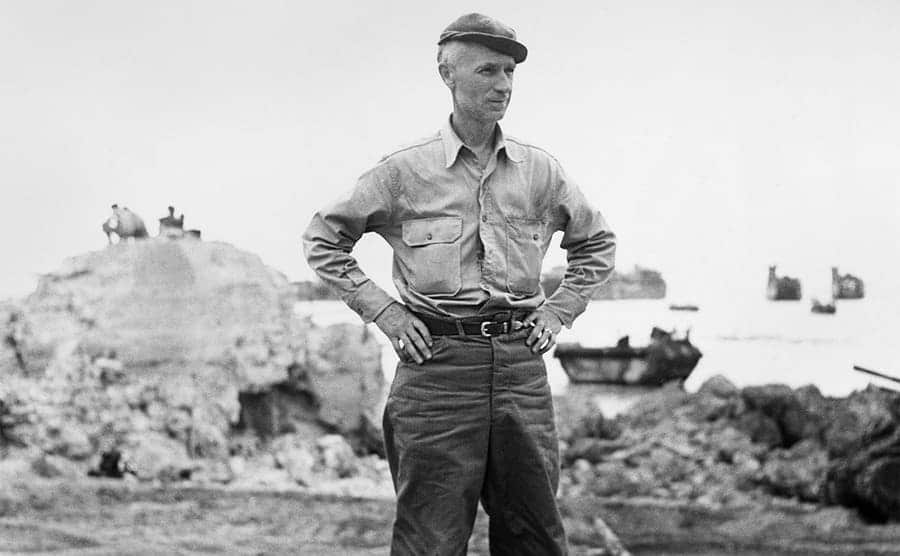 Ernie Pyle standing with his hands on his hips circa 1942