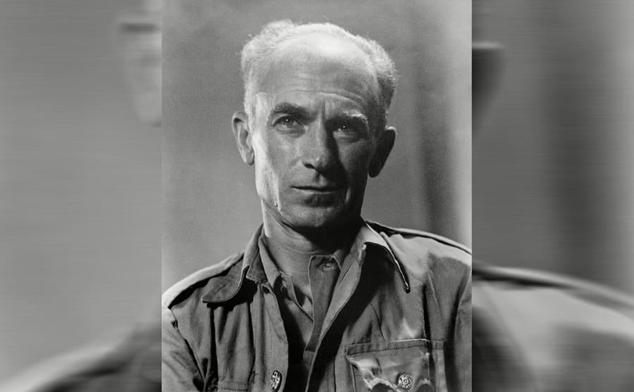 A portrait of Ernie Pyle balding with grey hair