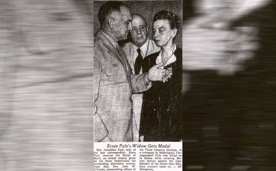 A newspaper clipping of Ernie Pyle's wife receiving a medal for his work