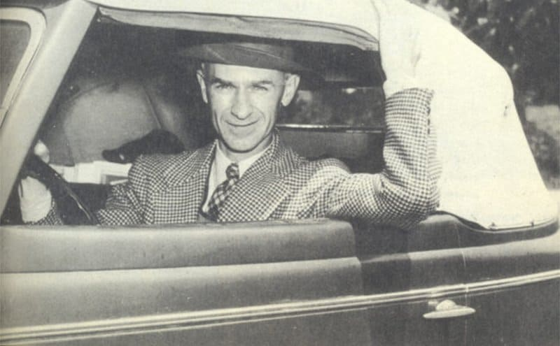 Ernie Pyle in the driver's seat of his car