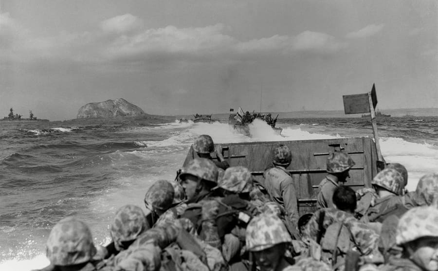 Soldiers approaching Iwo Jima