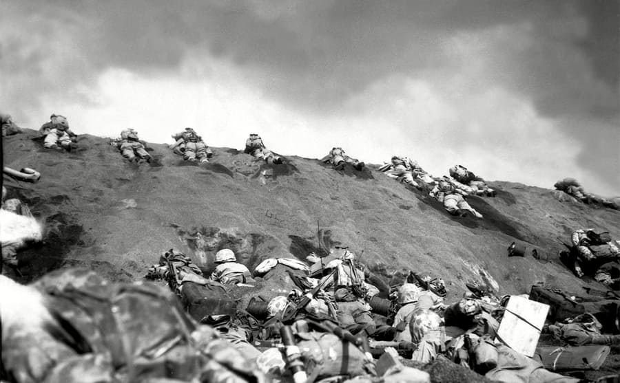 Soldiers crawling up a slope