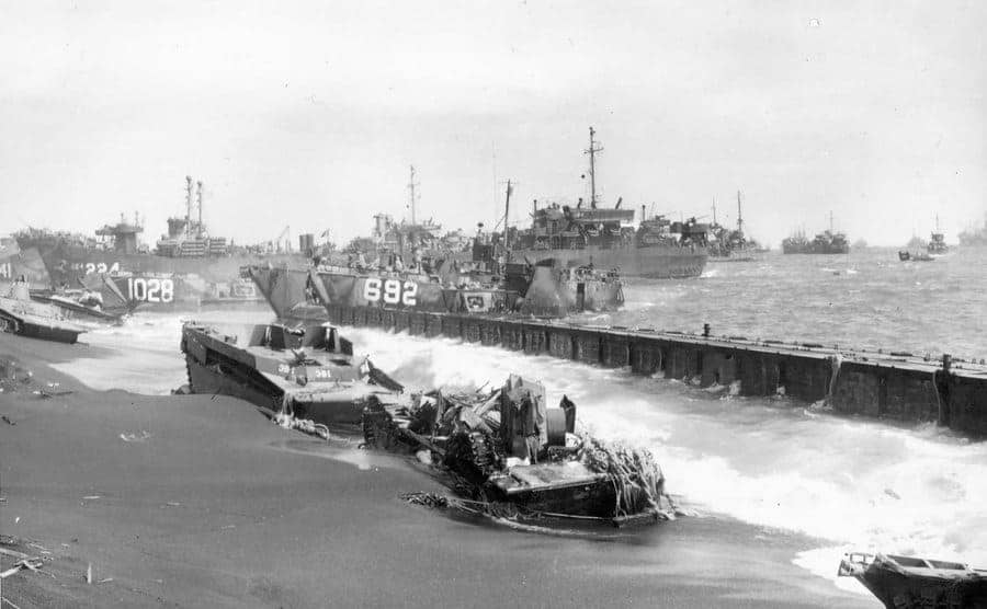Amphibious landing craft and equipment on military ships on Red Beach 1