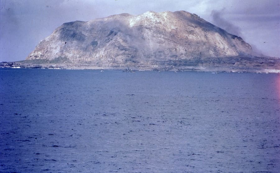 Black smoke over a volcanic mountain