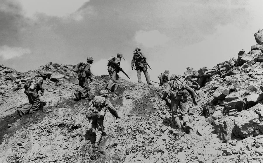 Soldiers climbing on a mountain