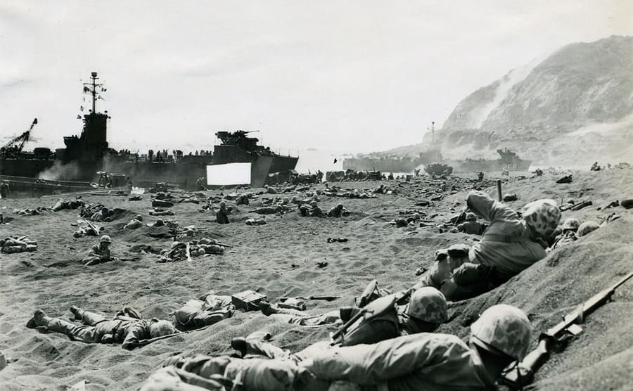 Soldiers hiding in volcanic sand