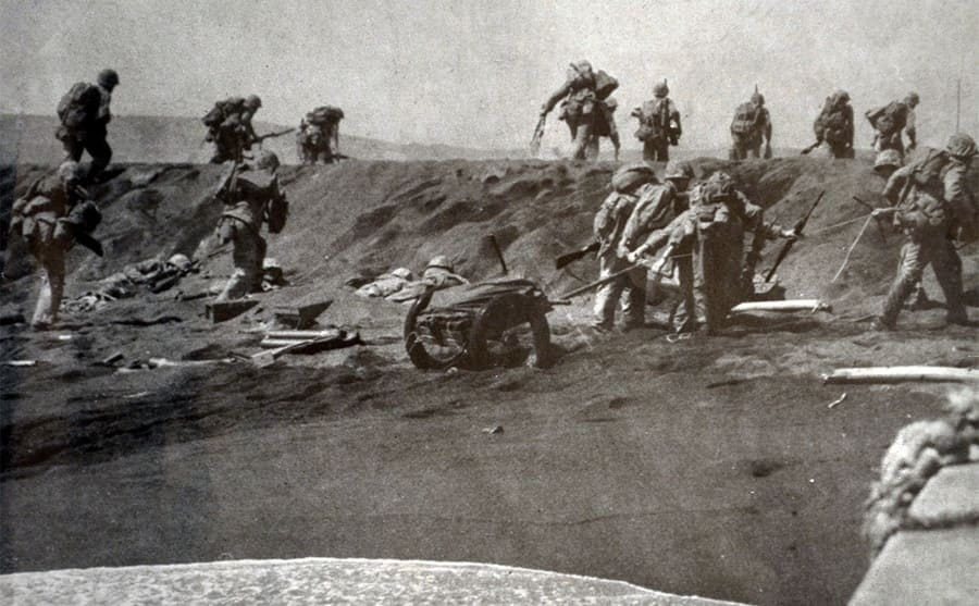 Soldiers running up a hill